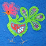 Bird laying (machine embroidered and quilted)